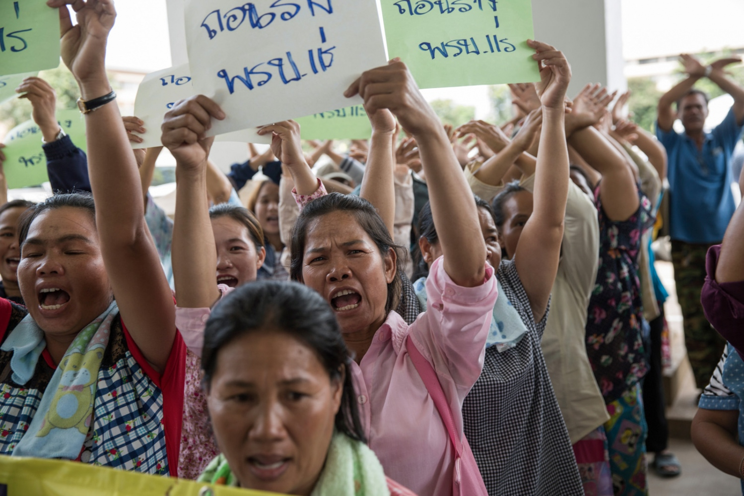 Members of the Khon Rak Ban Kerd environmental group and the Rak Ban Han Naew Group, a community-based group of villagers from Pak Chom District opposing a coal mining project gather at City Hall in Loei city in July 2016. They are submitting a petition to oppose the drafted mining act which could restrict public participation in mining permissions and reduce the robust environmental safeguards which have to be approved before operating a mine.
