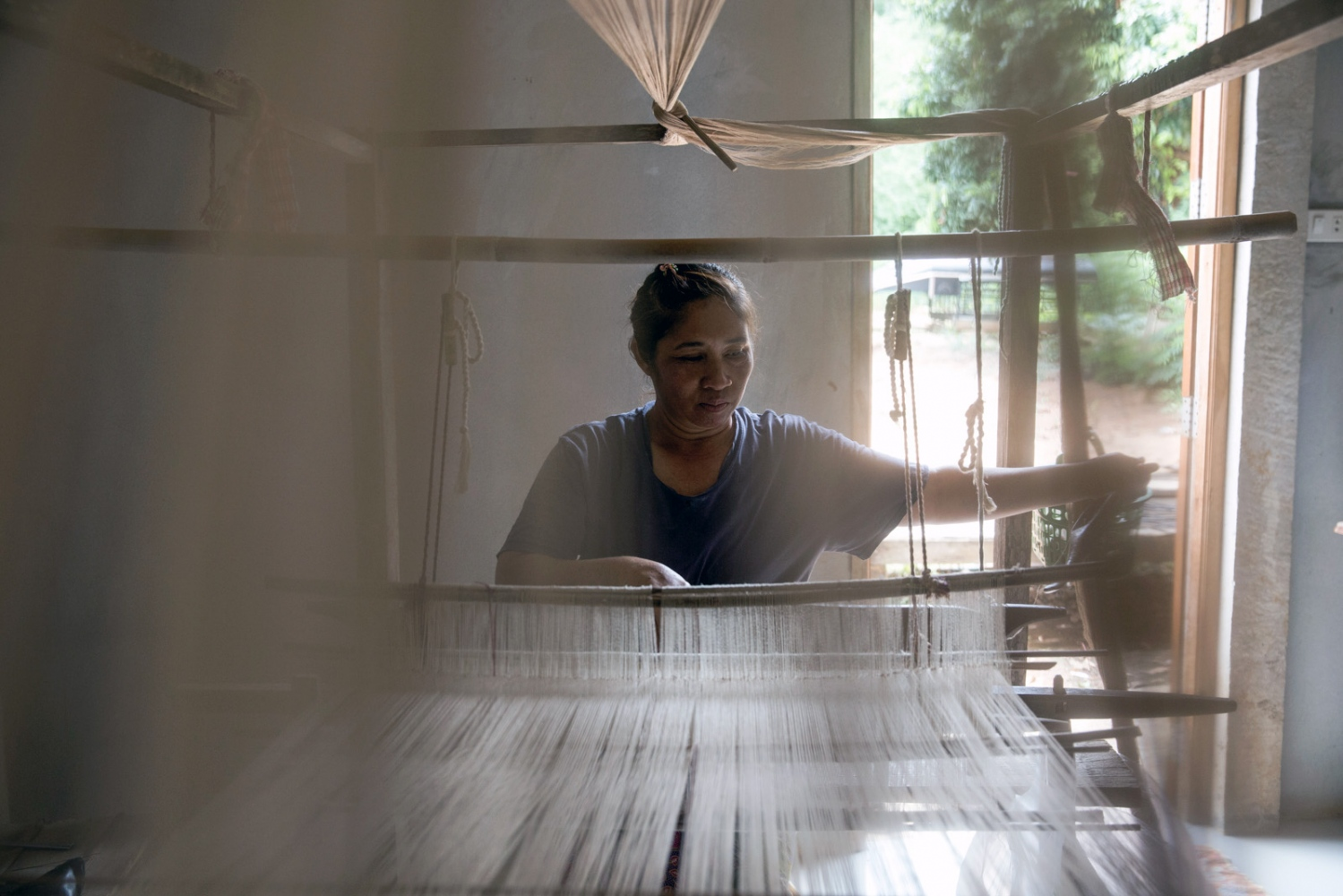 To raise additional income to suppliment any loss of work caused by their activism, women of the Khon Rak Ban Kerd environmental group weave and sell their products.