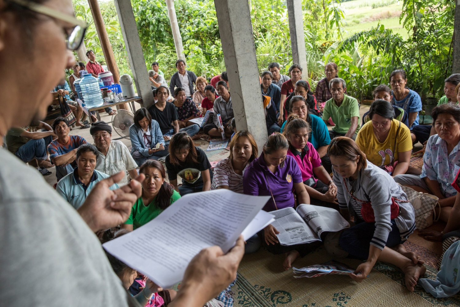 Environmental activist Lertsak Kumkongsak (left) talks to members of the Khon Rak Ban Kerd environmental group, the Rak Ban Han Naew Group and a community-based group of villagers from Pak Chom District opposing a coal mining project. They gather here prior to a protest march on City Hall in Loei city in July 2016. Because of Khon Rak Ban Kerd's experience in fighting environmental issues they now help, assist and train other groups who have just begun.