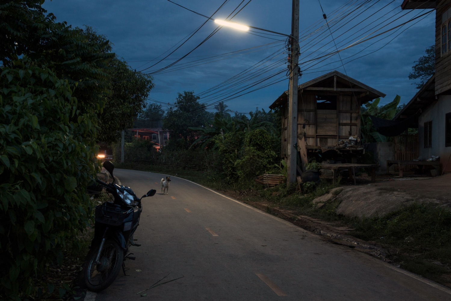 A quiet street at dusk in Na Nong Bong village.