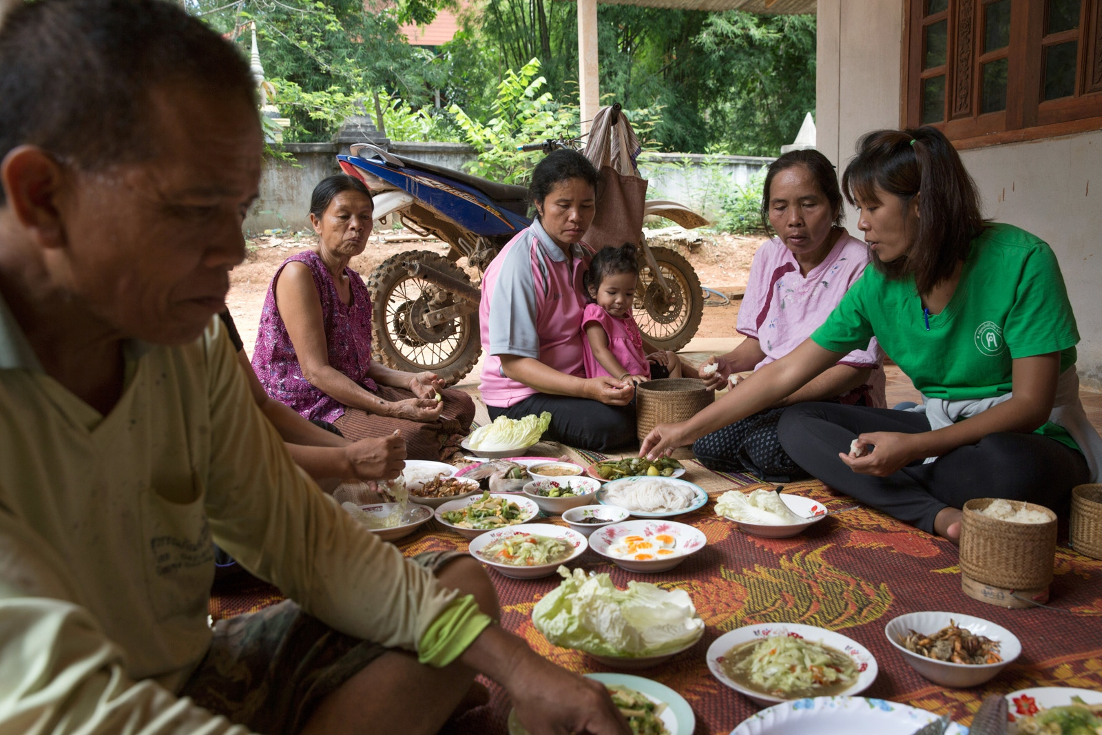 Core members of the Khon Rak Ban Kerd environmental group eat together after a court appearance in the Provincial capital Loei.