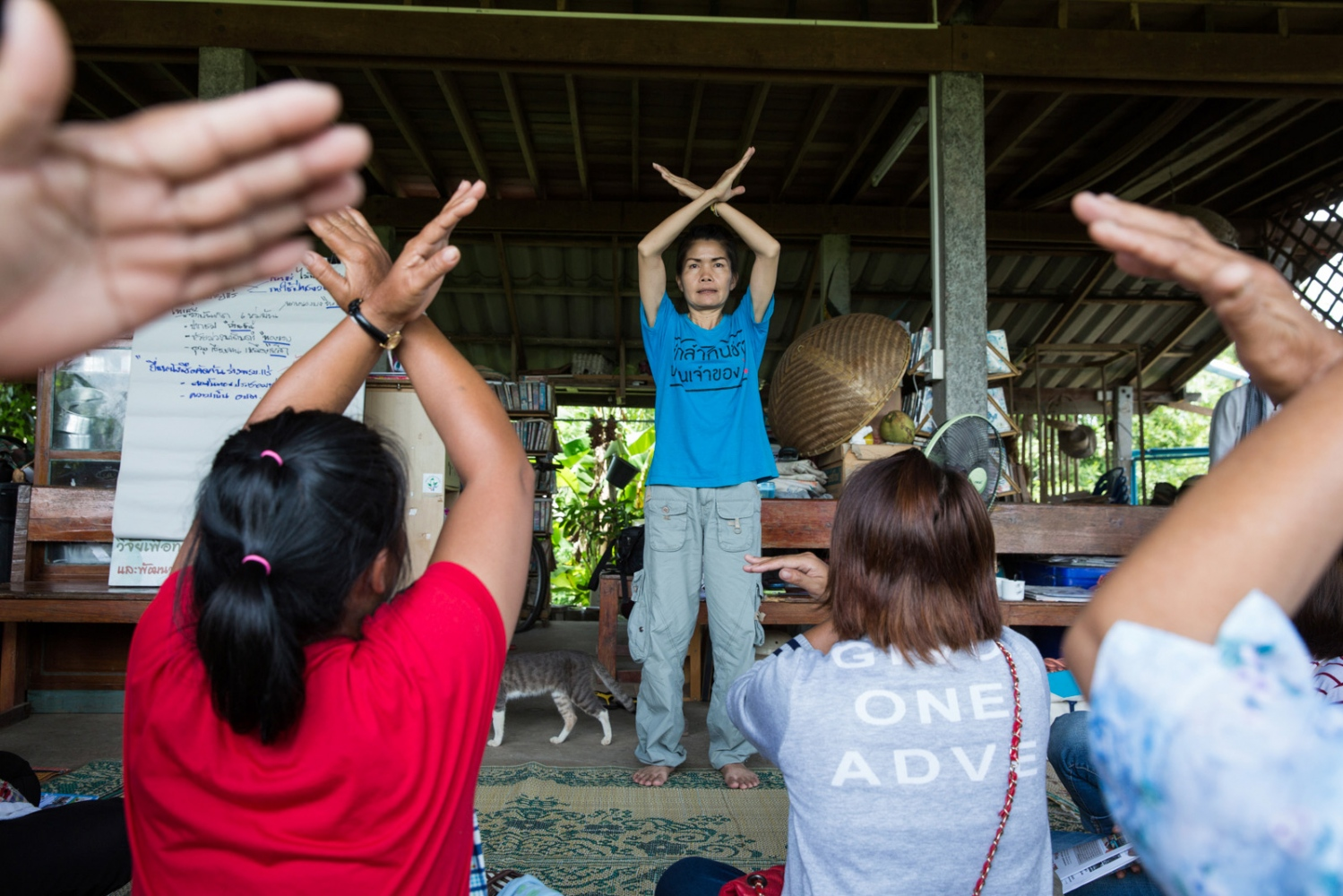 "Before a protest march at Loei City Hall in July 2016 Pornthip Hongchai leads a practice of the action they will take whilst shouting ""Go away mine""."