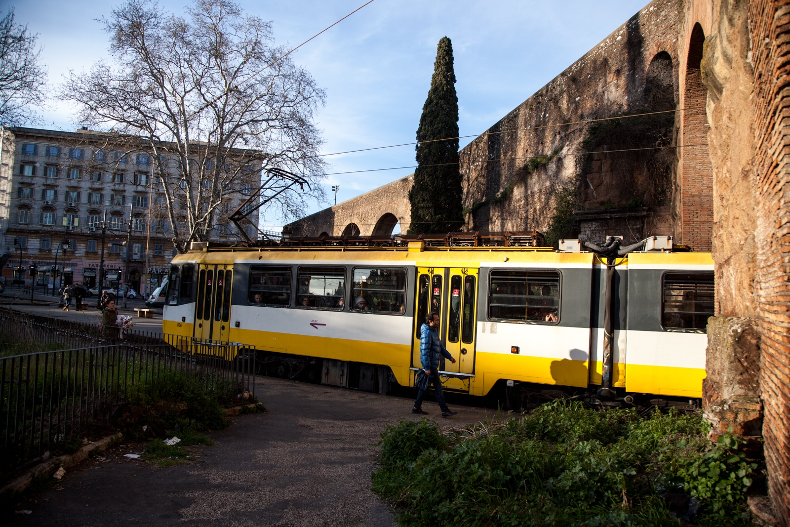 March 27, 2018 - A cable car makes a stop in Porta Maggiore. The square is a meeting point of many different lines of public transportation in Rome, from the multicultural suburbs all the way to the main train hub of Termini. Sometimes after the afternoon prayer, local imams who preach in the closer neighborhoods of Torpignattara and Centocelle take these trains to find new people to invite to the mosque.