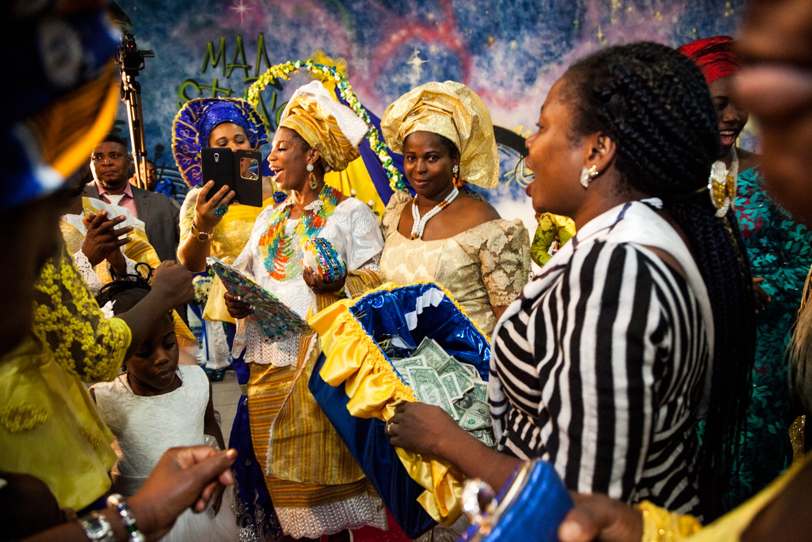 Oct. 2, 2016  - Testimony, a young bride from Nigeria, dances with her friends and relatives during her wedding reception. Testimony and Mike, both from Nigeria are members of the Apostolic Church, God's Mercy Family, in Torre Angela, a working class neighborhood in the far eastern suburbs of Rome.