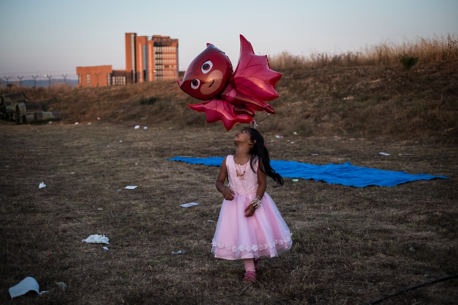July 30, 2017 - A little girl plays with a balloon before the Maghrib prayer begins. The Bangladeshi community of southern Rome, rented a big space to vote for new representatives and this is the area designated for the prayer.