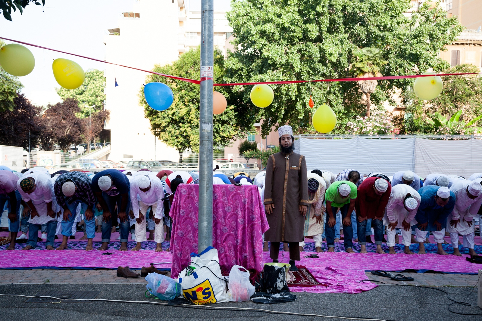 July 6, 2016 - Members of the Bangladeshi community of Rome perform the Eid al-Fitr prayer, that marks the end of Ramadan, in a public square in Torpignattara, a working class neighborhood in the southeastern suburbs of Rome.