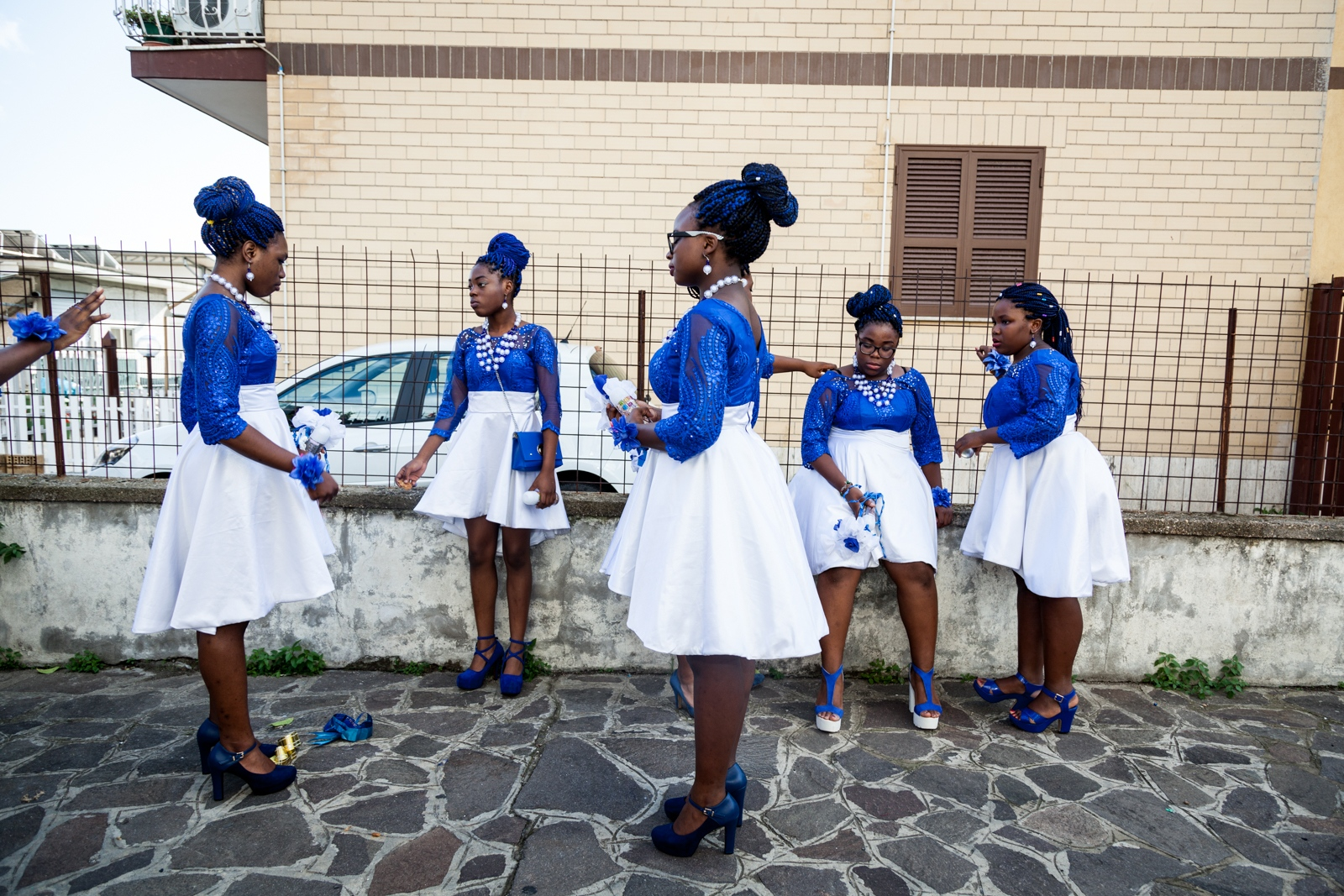 Teenagers members of the Apostolic Nigerian Church, God's Mercy in the southeastern neighborhood of Torre Angella gather outside the church before a wedding.