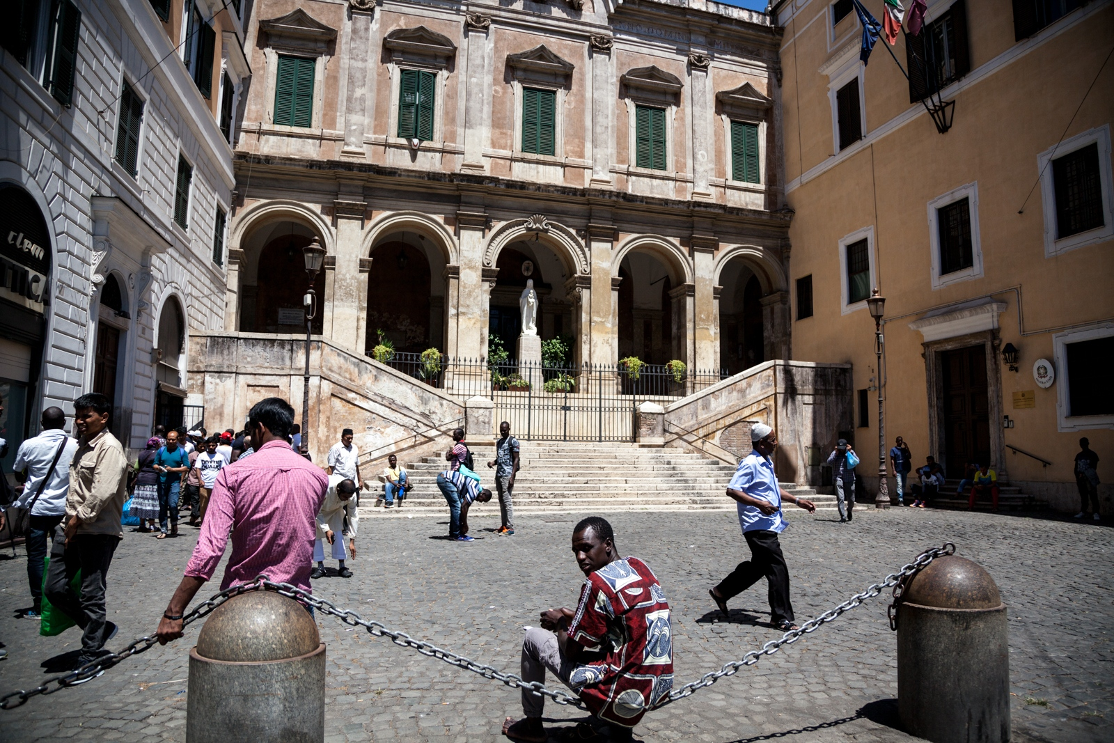 July 07, 2017 - After the Friday prayer, men leave a small Mosque next to a Catholic Church (Chiesa di Sant'Eusebio) in Piazza Vittorio, one of the most multicultural areas of Rome.