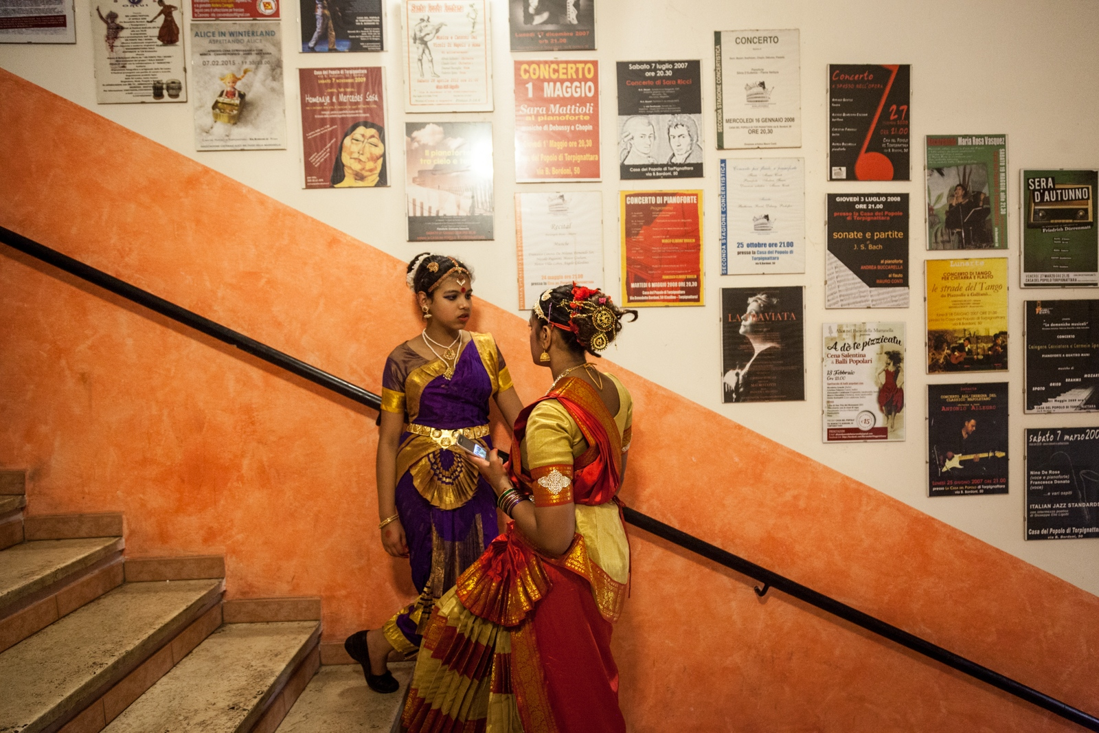 Oct. 8, 2016 - Two girls talk outside the theater during  Durga Puja celebration that took place in a community center in Torpignattara, a working class neighborhood in southeastern Rome, where many different immigrant communities live and work.