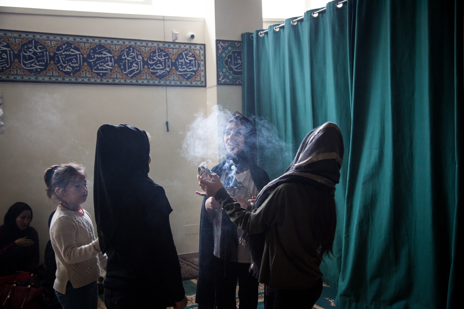 Oct, 1 - 2017 - Girls play with incense during the celebration for the day of Ashura at the Islamic Centre Imama Mahdi, in the southern area of Rome. The centre is the only Shia mosque in Rome.