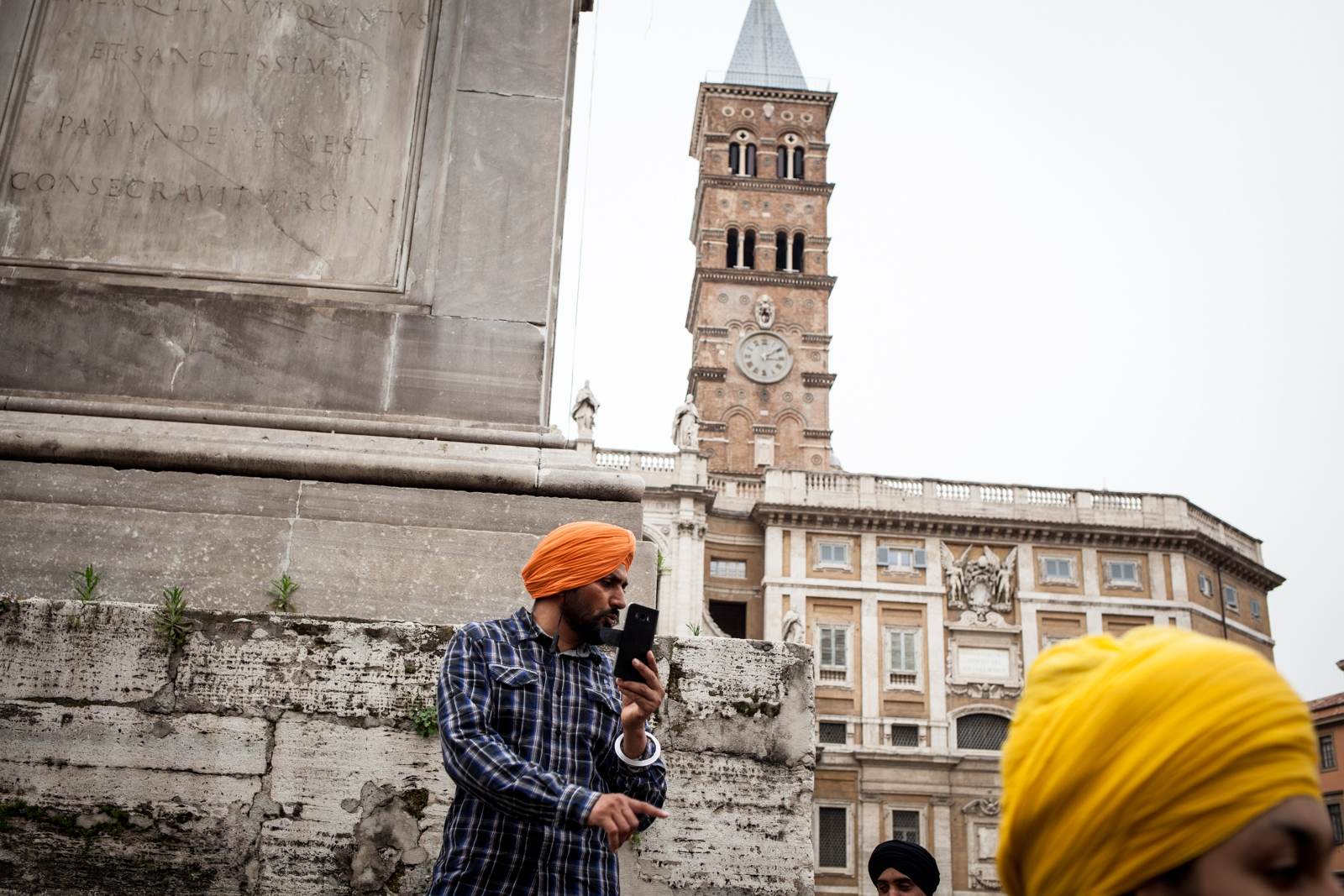 Apr. 15, 2018 - Men wait for the procession to arrive in Piazza di Santa Maria Maggiore, in the multicultural neighborhood Esquilino. Every year the area hosts the Vaisakhi Nagar Kirtan, the most important religious event for the Sikhs. Hundreds of people from all over Italy gather in the square for prayers, sacred chants  and a communal meal.