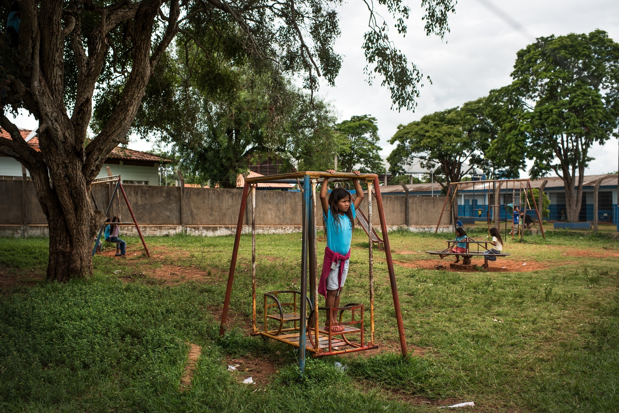 November 29, 2016.  Children play in a schoolyard in the Guarani-Kaiowa Amambai Indigenous Reserve in Matto Grosso Du Sul, Brazil.
