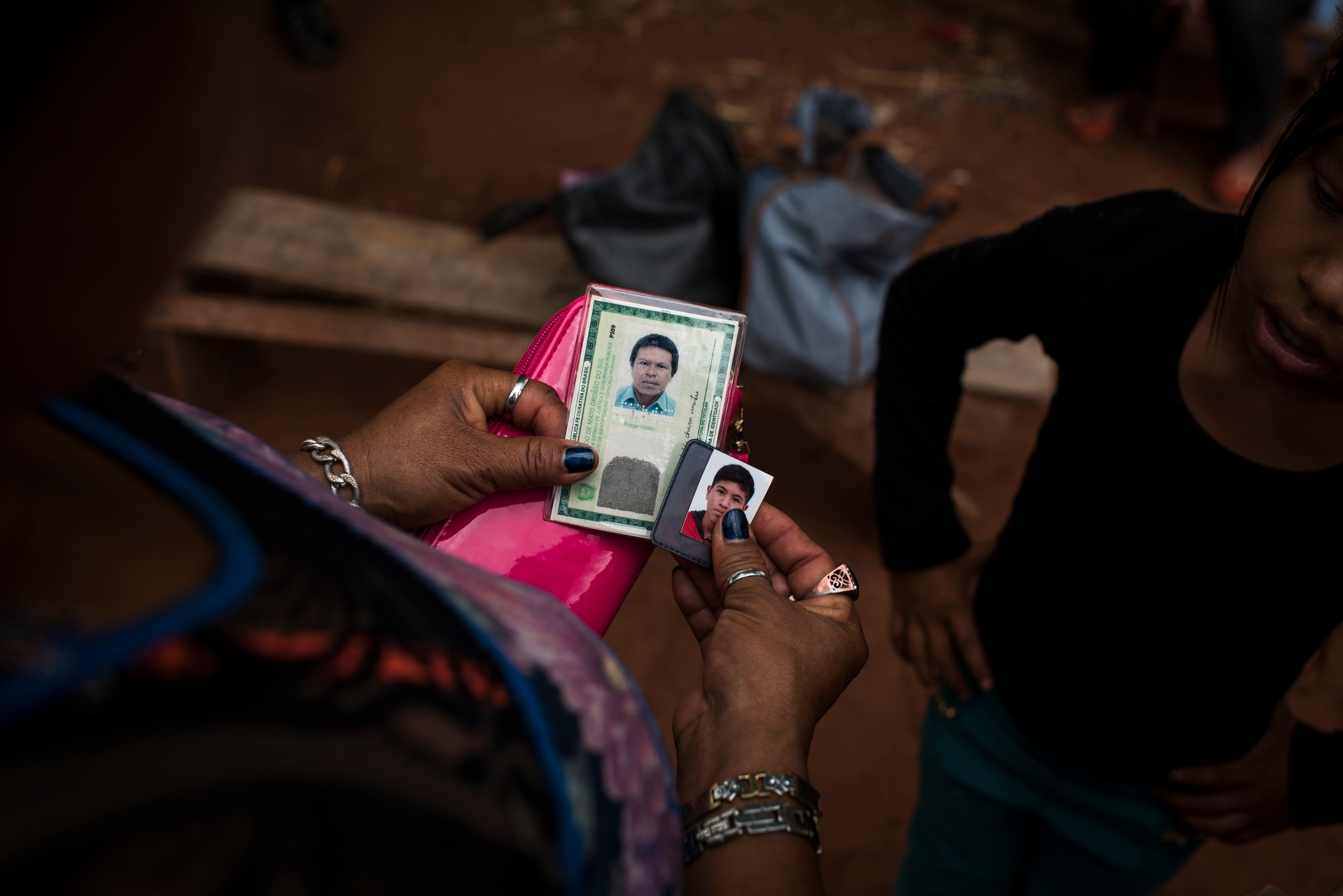 November 29, 2016.  Araci Samor, 41, holds two photos of her husband Nivaldo Chara Martin, 42, and son Michelleu, 15, in the Guarani-Kaiowa Amambai Indigenous Reserve in Matto Grosso Du Sul, Brazil. Her husband committed suicide last christmas day and her son o a year ago on January 2. Her daughter Nicole Sarmori Martin looks on. The reserve has one of the highest suicide rates in the world.
