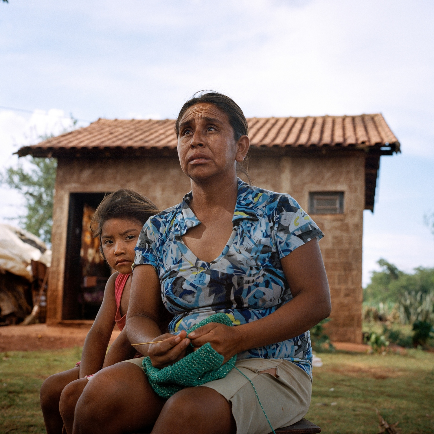 November 28, 2016. Lara Souza and her mother Mara Souza, the x-wife of Onildo de Oliveira who committed suicide in the Dourados Guarani-Kaiówa Reservation in Matto Grosso Du Sul, Brazil. Oliveira committed suicide the previous week, he had spoken about his inability to get work and support his four children, although he had never mentioned thoughts of suicide. He was 39 years old.