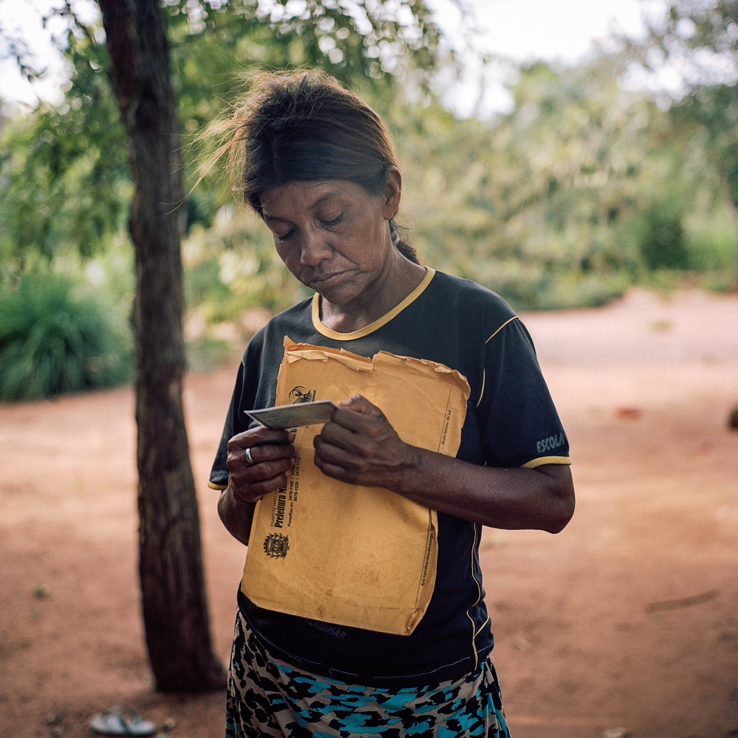 November 30. Maria Silveira, looks at a photo of one of the two sons she lost to suicide, Gilmar, 16, and Junior, 21, to suicide in the community of Sassoro where 10 people killed themselves last year.