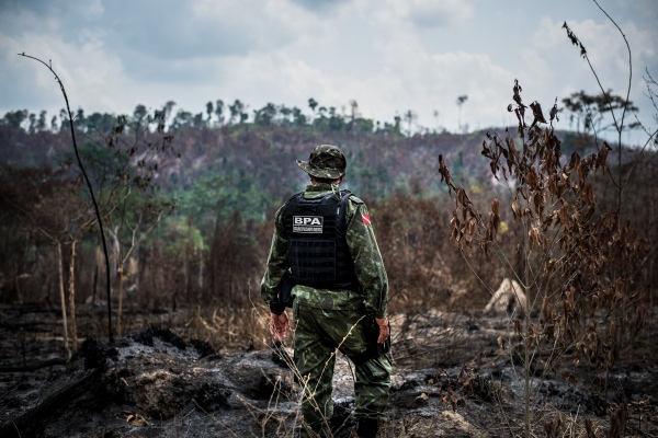 Millitary police and Agents with ICMBio, assigned to protect conservation areas around Novo Progresso, one of the worst deforestation zones in Brazil. The team, which has one agent per one million hectares of forest, uses satellite imaging to track new forest clearing and fires. Here on an operation in the Jamanxim National Forest, where an area had been recently cleared by ranchers.