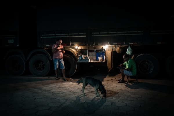 Truck drivers have a meal at a truckstop off the side of the BR-163 in Para state, Brazil.