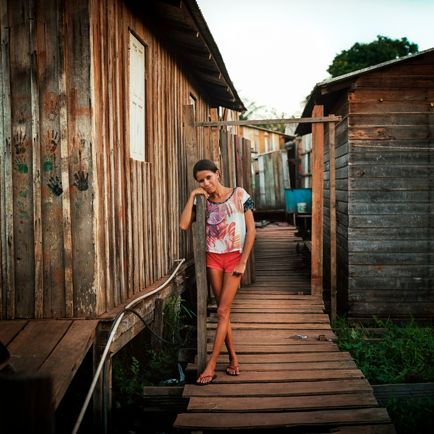 2017. Kaciani da Silva lives in the slum neighbourhood of Palaffitas in the city of Altamira, Para, Brazil. The neighbourhood is built on a lagoon that is now rising and flooding homes to a degree that had never been seen before the construction of the Belo Monte Dam. Norte Energia, the consortium responsible for the dam, denies that the dam is resposible for the flooding.  /Aaron Vincent Elkaim