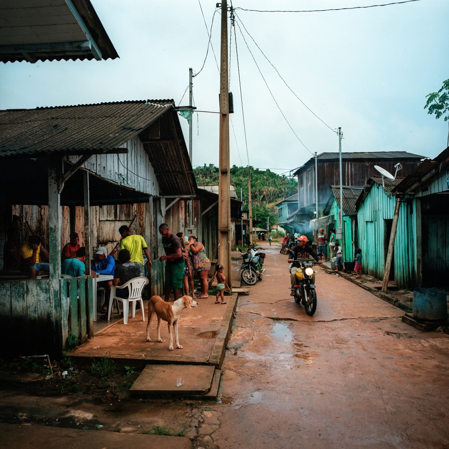 2017. People are seen in the streets of Ressaca, a Garimpero gold mining communtiy where the Canadian owned Belo Sun gold mine is planned to be built. Belo Sun will be the largest open-pit gold mine in the country and will excavate an estimated 60 tonnes of gold during its lifetime. In 1992 when the community was booming there were over 8,000 garimpeiros, today there are just 400 to 500 remaining. In 2012 police and environmental inspectors began to crack down on the community and their co-operative lost its mining license severley impacting the livihood of the community. Belo Sun obtained an advance license in 2004, which recognises the environmental viability of the project and on Feb. 2, 2017 the Environment and Sustainability department of the state of Pará granted it a permit to build the mine. Three weeks after the license was approved, Para's justice court suspended the project for 180 days, accusing Belo Sun of illegally purchasing public lands, and ordering them to properly relocate local communities that will be displaced by the project. Yet still many residents of the communtiy support the mine as they are hopeful to gain employment. Downstream indigenous communities were not consulted by the project. Aaron Vincent Elkaim / The Alexia Foundation.