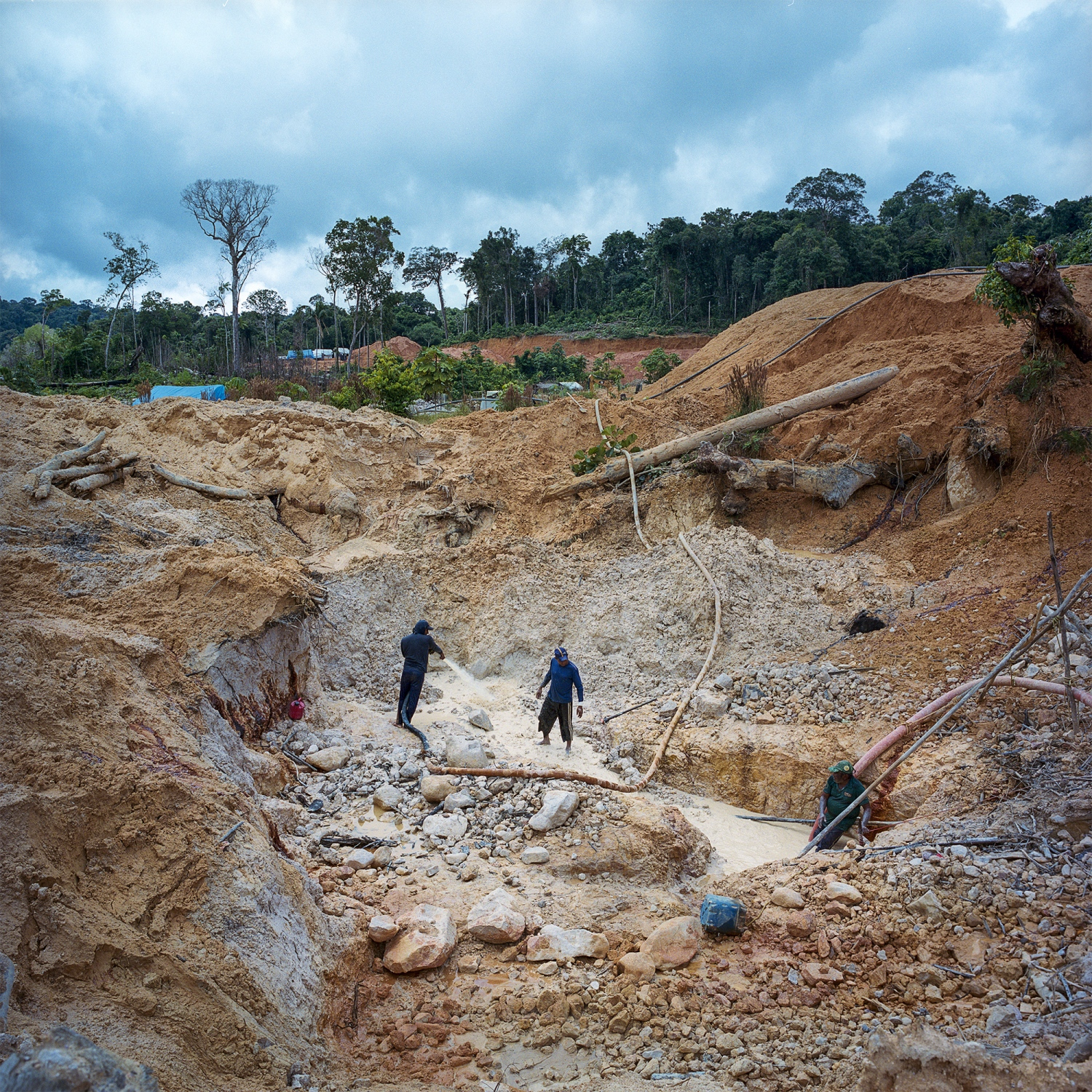 2016.  Garimpero or artisinal gold and diamond miners work at mine called Chapeo du Sol on the Tapajos River in Para State, Brazil. Much of the energy from new hydroelectric projects is planned to power large scale mining projects within the Amazon such as the proposed Belo Sun gold mine near Belo Monte. /Aaron Vincent Elkaim