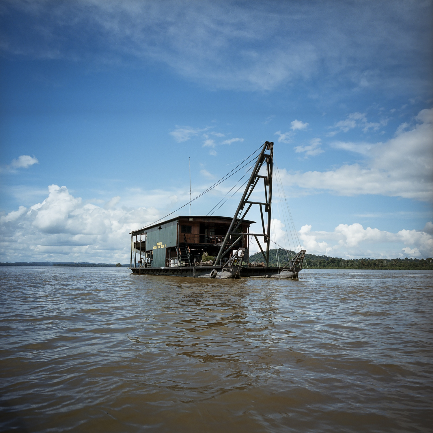 2016.  Gold dredging boats such as this one are a common sight on the Tapajos River in Para State, Brazil. The river was once very clear, but the constant dredging has made it much muddier in recent years.  /Aaron Vincent Elkaim