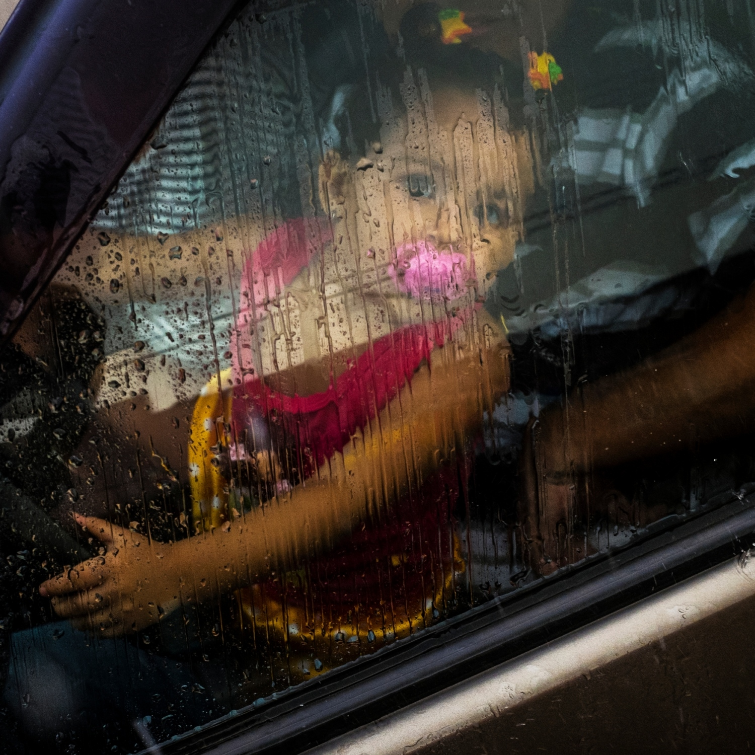 2014. A child watches a Carnival parade from the drivers seat on rainy day in the City of Altamira, Para, Brazil.  /Aaron Vincent Elkaim