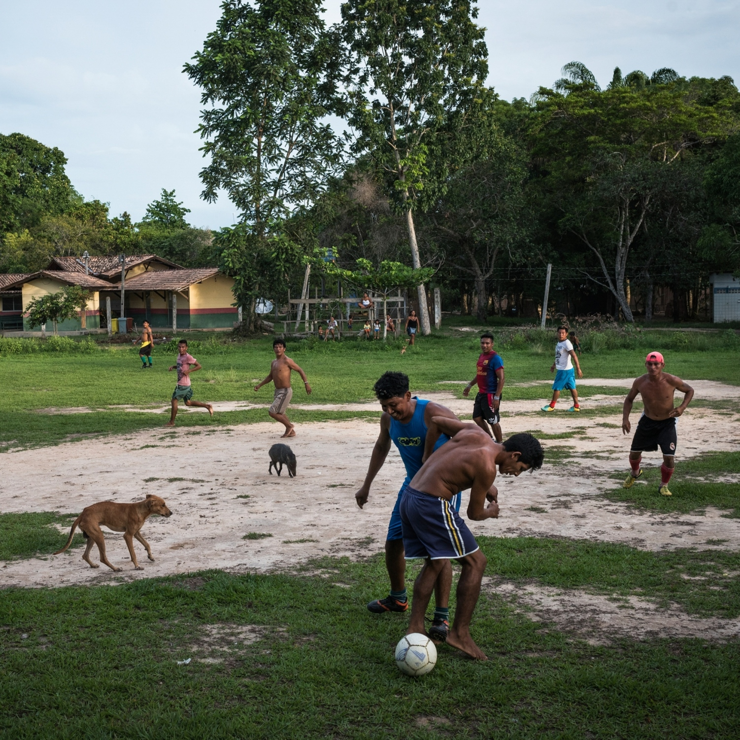 2016. Munduruku from the villages of Praia Do Indios, L'Aranjao and Praia Do Mangue play a evening match of Foot Ball in the village of Praia Do Mangue near the city of Itaituba in Para state, Brazil. /Aaron Vincent Elkaim