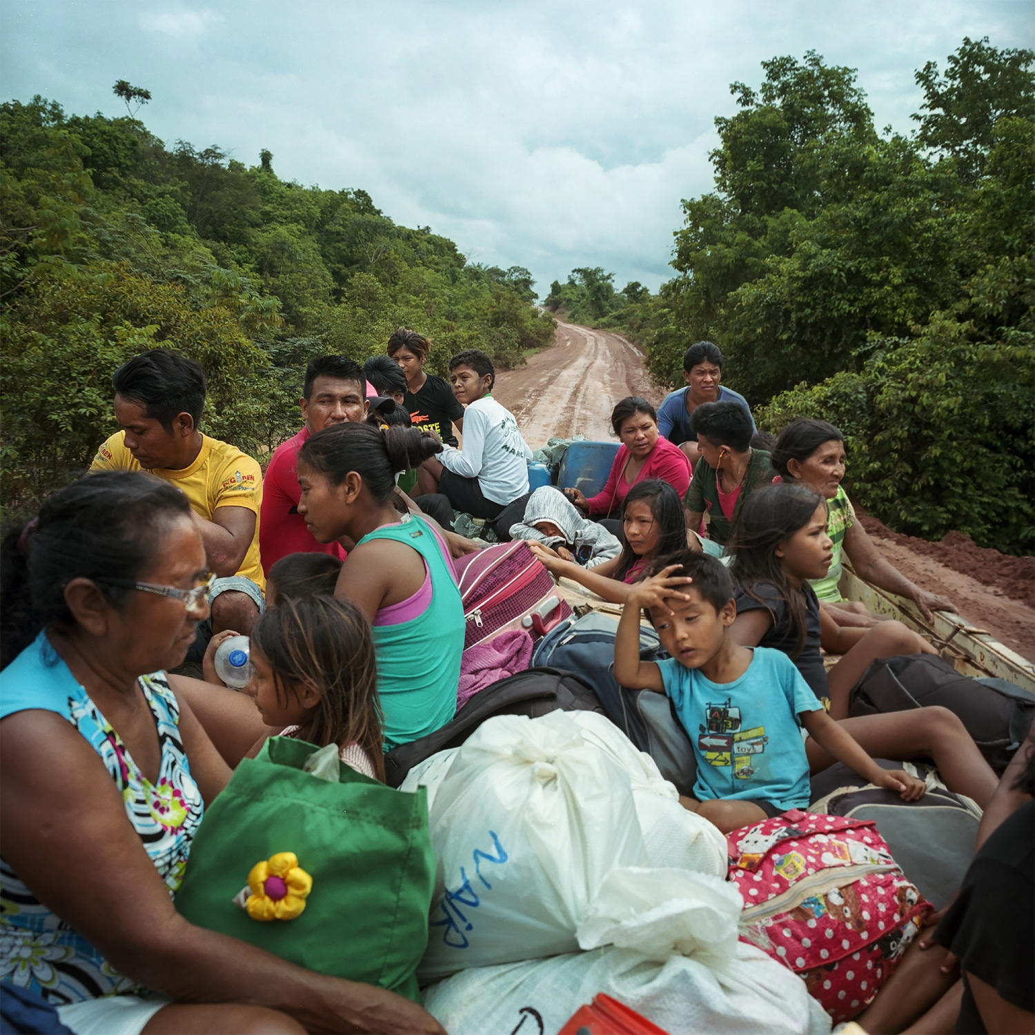 March 6, 2016.  Munduruku indigenous people ride in the back of a truck on the Transamazon hightway from the city of Itaituba to the port of Buburé as they return to their villages on the Tapajos River in Para State, Brazil.  The Munduruku are a tribe of 13000 people who live traditionally along the river and depend on fishing and the river system for their livelihood.  /Aaron Vincent Elkaim