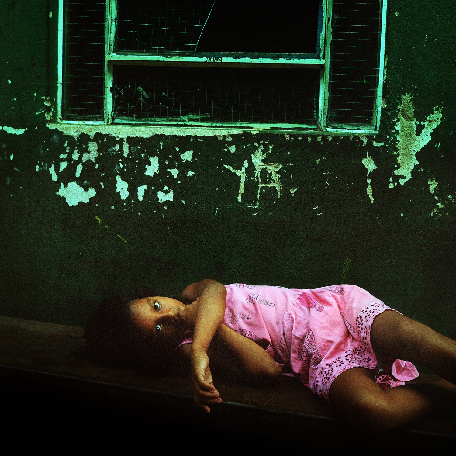 February 21, 2014. A Xipaya girl rests while staying at the Casa do Indio in Altamira. The Casa is a run down building where indigenous people stay while visiting the city. They visit to access government services, for medical care, and often to sell the natural products they harvest from the forest.  /Aaron Vincent Elkaim