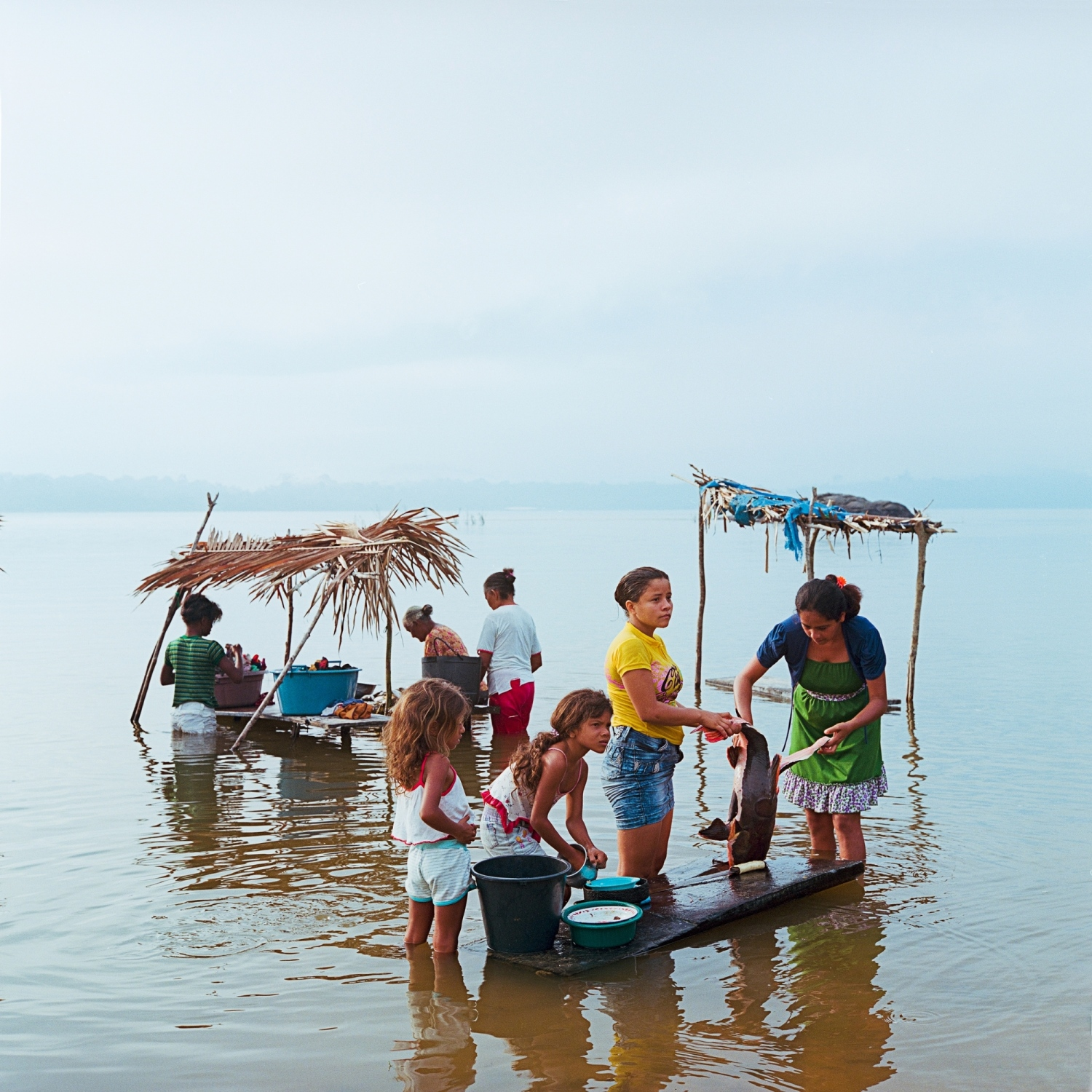 "December 4, 2014. An Extractavist family from the traditional riparian village of  Mangabal on the Tapajos River. Extractavists came to the forests generations ago during Brazils Rubber Boom and continue to live a traditional way of life. Over 40 dams are planned for the Tapajos river, the largest the ""Saõ Luiz Do Tapajos"" was recently suspended, but is still discussed amongst politicians. If built, it would flood the territory of Mangabal. /Aaron Vincent Elkaim"