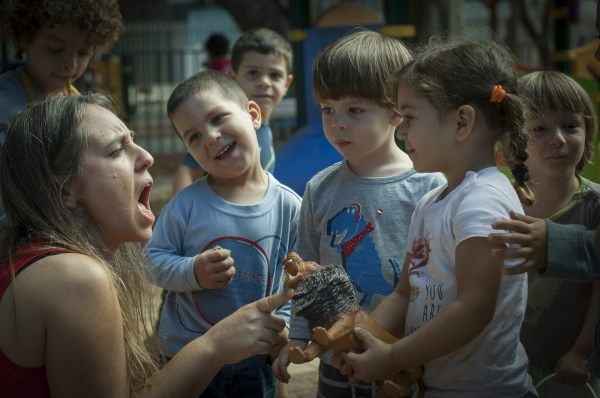 Students play together during break time with one of their teachers at the Jaffa Hand in Hand School.