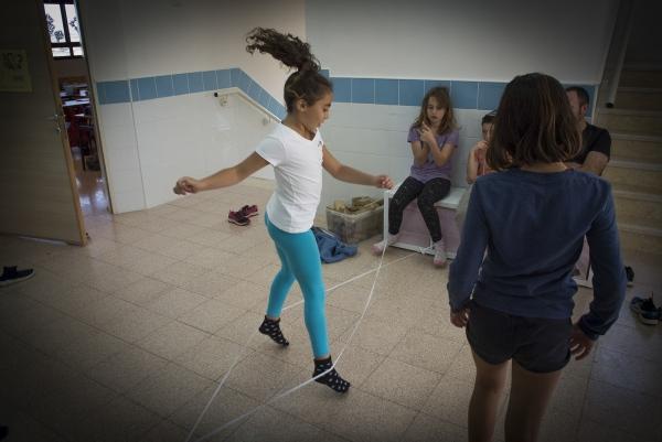 Arab and Jewish children Children play together during break time. Hand in Hand School,