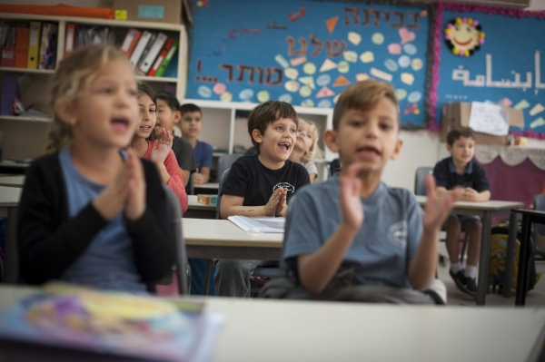 Lessons are taught simultaneously in Hebrew and Arabic to both Jewish and Arab children.