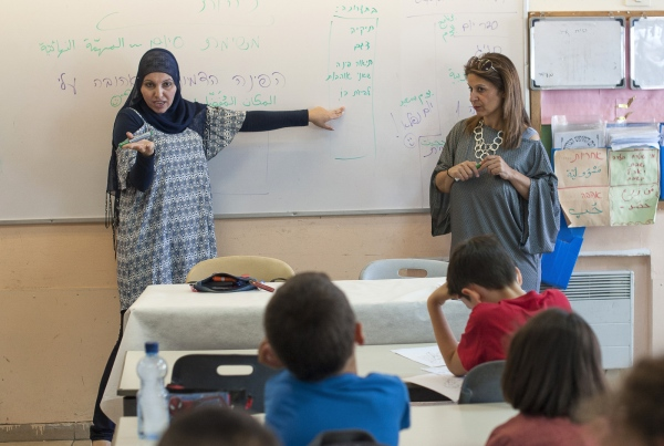 One mixed class with two teachers. Lessons are taught simultaneously in Hebrew and Arabic.
