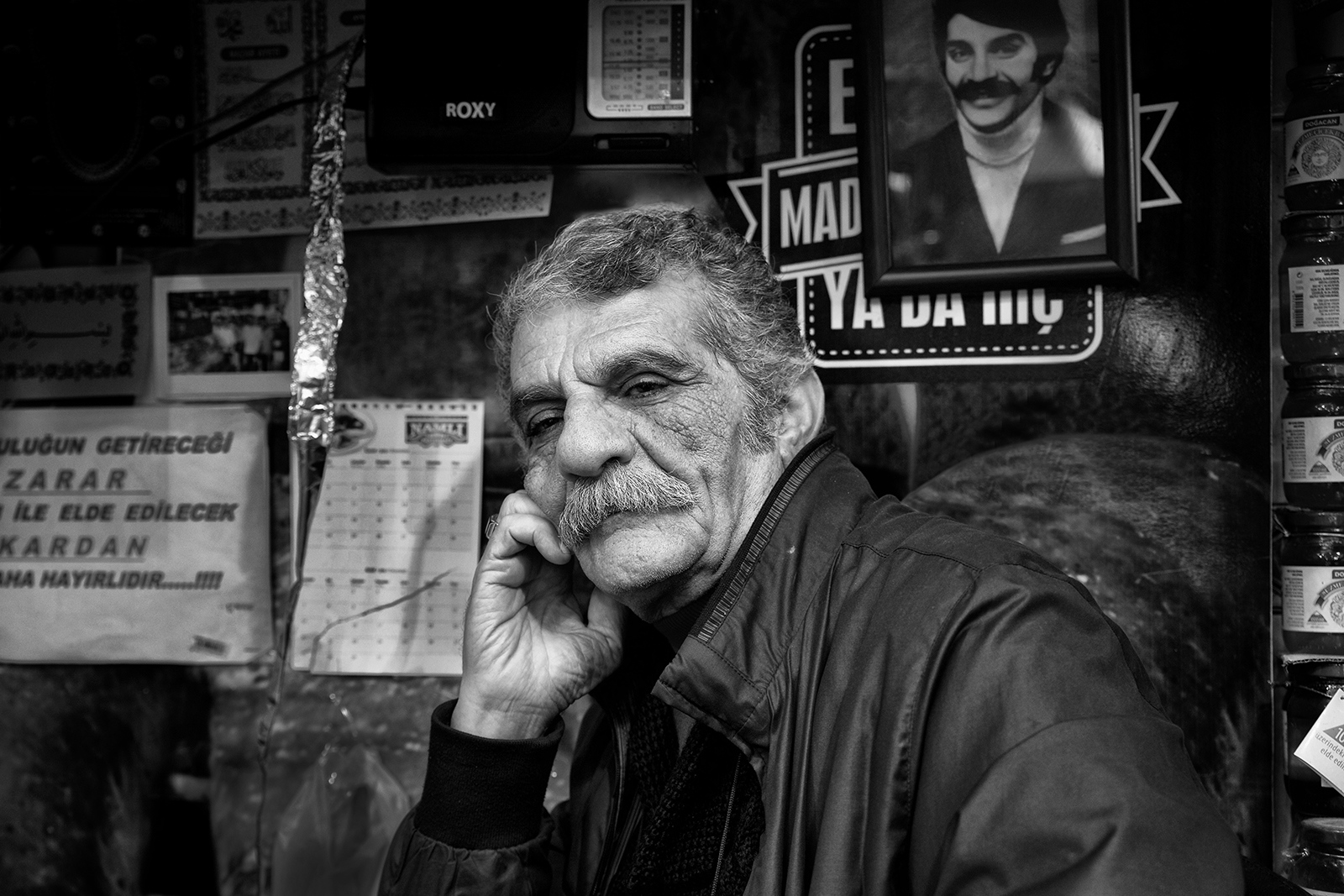 Istanbul 2016, Ashop keeper at the spice market posing in front of a photo of his youth.