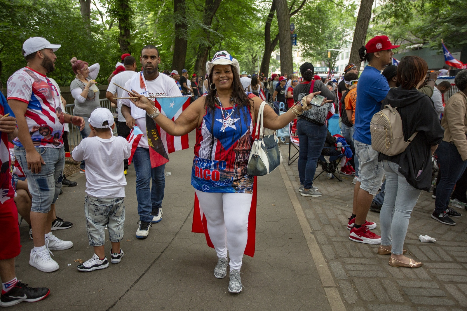 Tales From Trumpland. Puerto Rican Day Parade today, June 10, 2018, was not only a celebration of pride and joy but also a protest against the Trump administration's handling of the aftermath of Hurricane Maria a year ago. A new Harvard study published Tuesday in the New England Journal of Medicine estimates that at least 4,645 deaths can be linked to the hurricane and its immediate aftermath, making the storm far deadlier than previously thought. ( Kevin C Downs/Agence Cosmos)