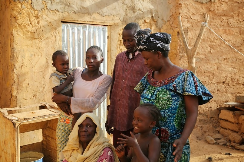 Married herself at 12, Naija said she felt relief in knowing her own daughters would be taken care of when they married as young adolescents. From left to right: Naija; her granddaughter, Ginika, 16; Ginika's son, Temidire; Ginika's husband, Miriodere, 42; Naija's second oldest daughter, and Ginika's mother, Rayowa, 43; Ginika's daughter, Chiagozie.