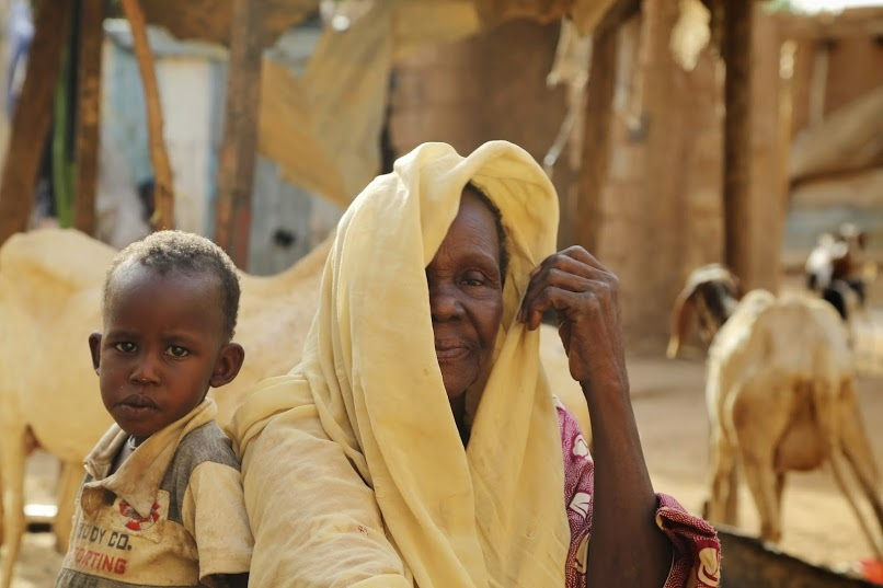 Naija and her grandson, Temidire, who lives with her, along with his mother, Naija's granddaughter, and three of her youngest children. Naija, 58, has 17 children and 55 grandchildren.