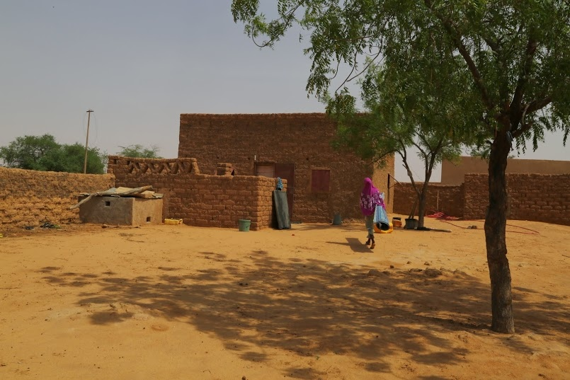 A young woman returns home after visiting neighbors in Filingue, a town in southwestern Niger.