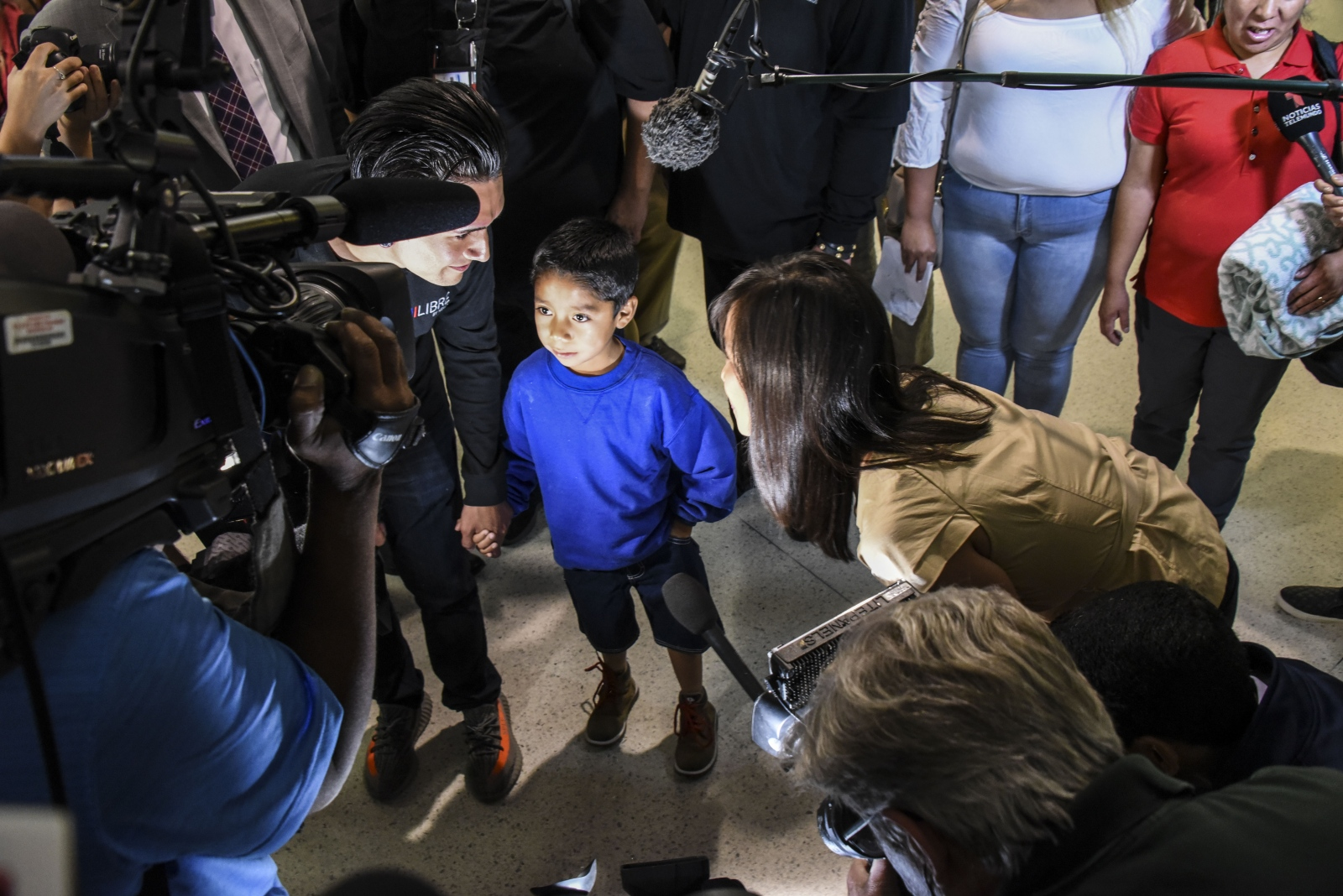 Darwin Mejia-Mejia is thronged my the media following his flight from Phoenix, Arizona to  Baltimore's BWI airport, where he was reunited with his mother, Beata Mariana de Jesus Mejia-Mejia  on Friday, June 22 at 2:25 a.m.
