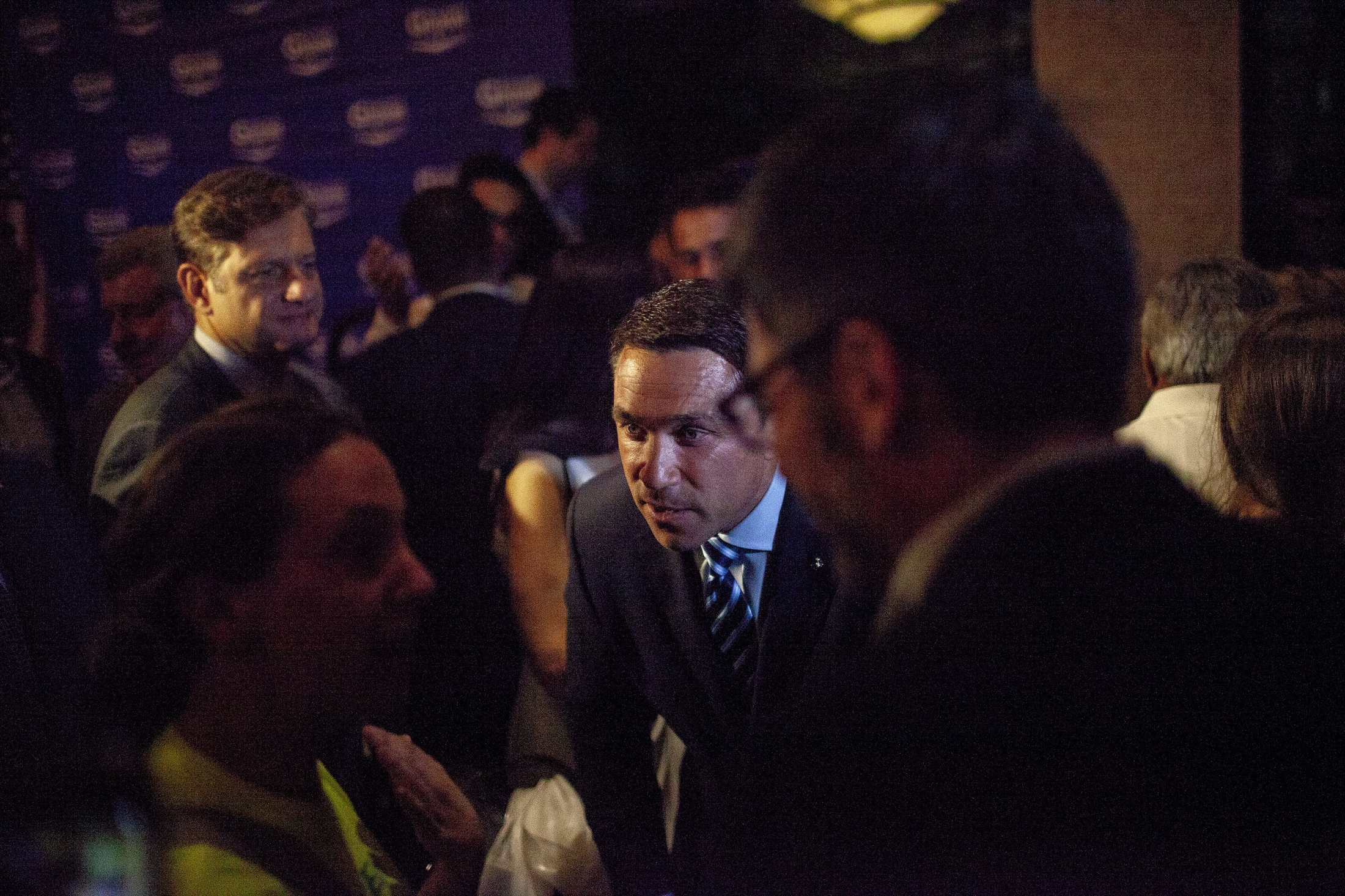 Tales from Trumpland, Republican Michael Grimm, after he conceded to Dan Donovan at the Hilton Garden Inn on Staten Island during the Republican congressional primary, came down to greet his supporters. Donovan had 64.2% of the votes vs. Grimm's 35.8%. Michael Gerard Grimm (born February 7, 1970) is an American businessman, convicted felon, retired Marine and politician who represented New York in the United States Congress from 2011 to 2015. Grimm represented New York's 13th congressional district during his first term, after which he represented New York's 11th congressional district. Both districts consisted of Staten Island and parts of Brooklyn. Grimm is a member of the Republican Party, and during his time in office was the only Republican to represent a significant portion of New York City. On July 17, 2015, Grimm was sentenced to eight months in prison for tax evasion. Staten Island, NY June 26, 2018 (Kevin C. Downs/Agence Cosmos)