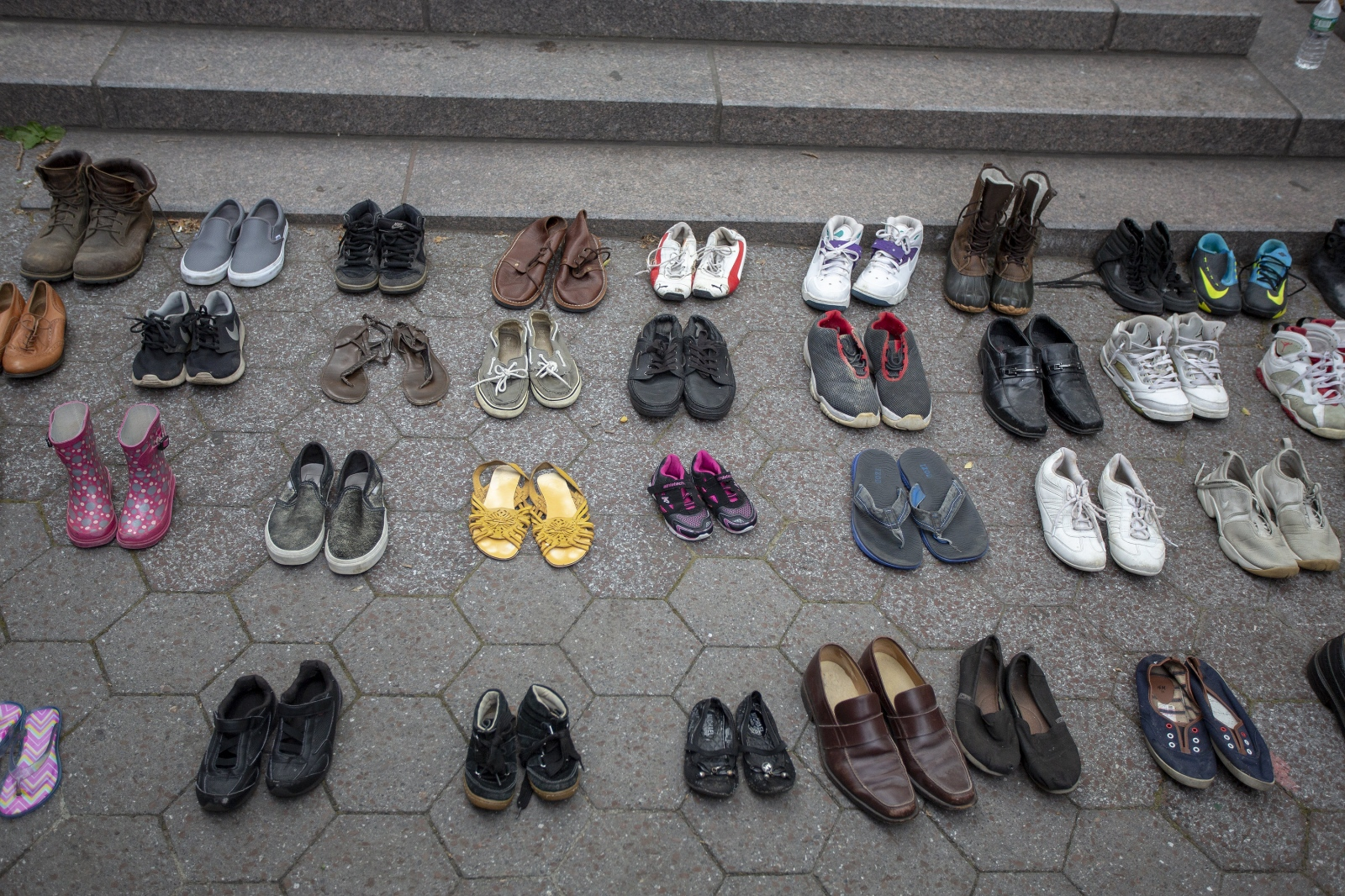 Tales from Trumpland. Shoes representing refugees that died trying to get to safety. June 20, 20018. World refugee day. ( Kevin C Downs/Agence Cosmos)