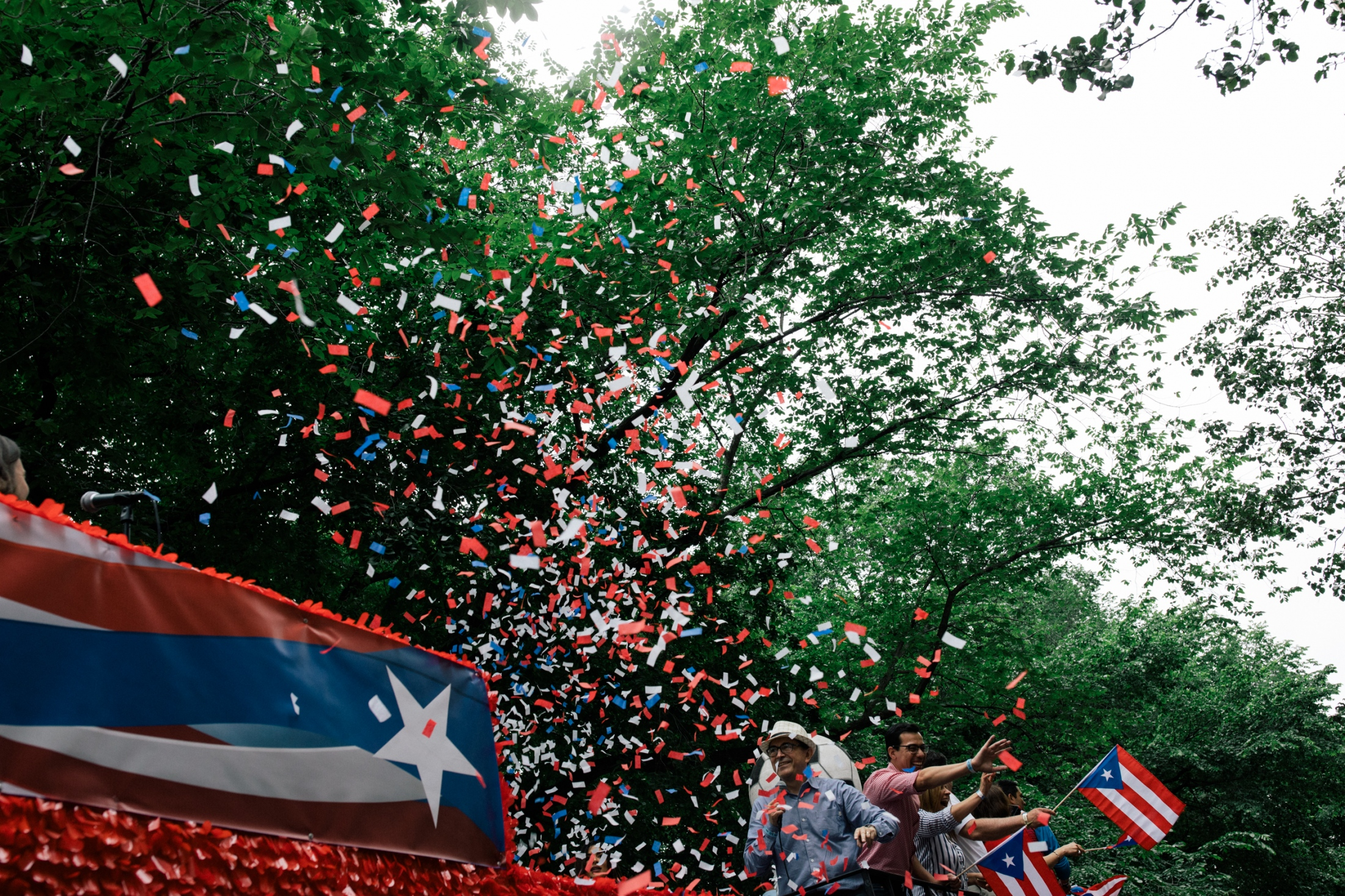 A float operated by the Spanish language channel Telemundo 47 releases confetti and hands out inflatable soccer balls at Fifth Avenue and East 61st Street.