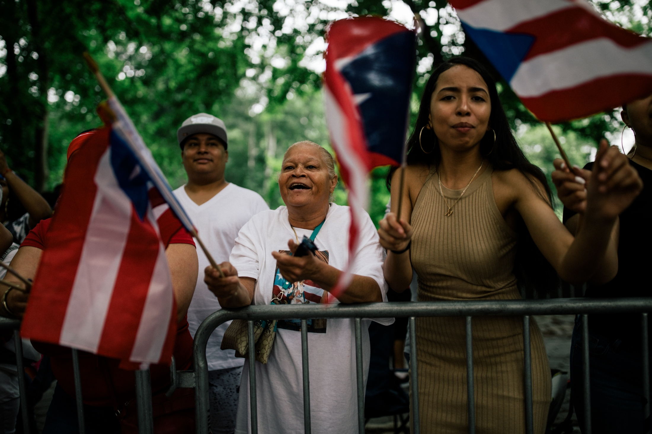 Crowd members take part in chants and wave their Puerto Rican flags at Fifth Avenue and East 71st Street.