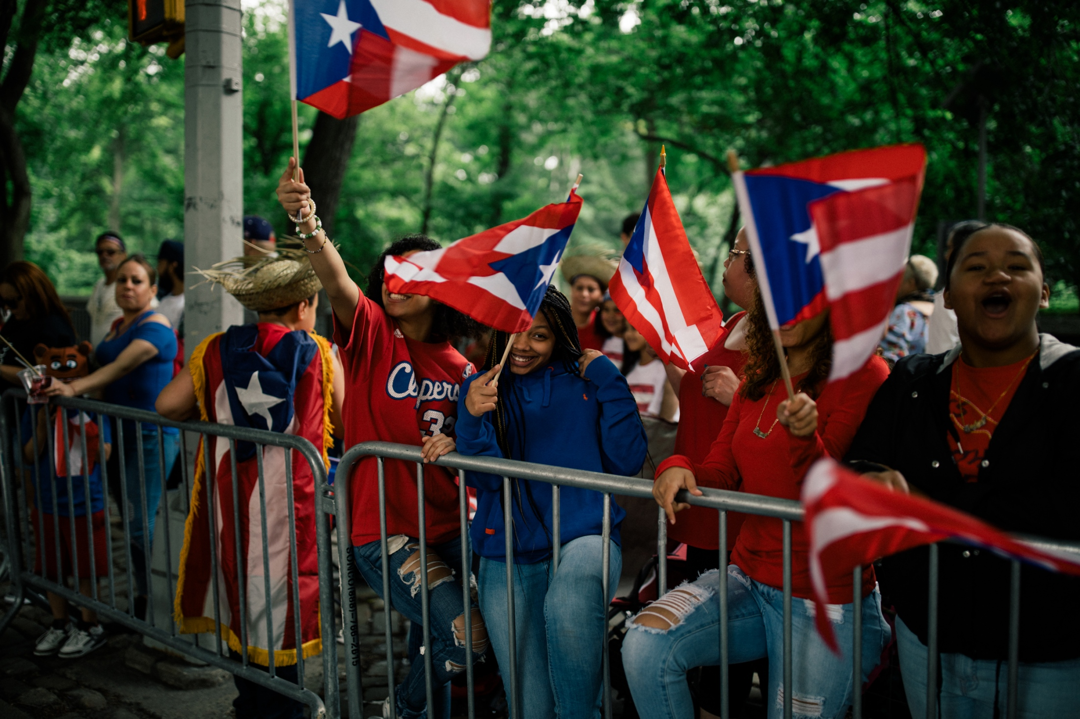Crowd members chant and wave their Puerto Rican flags at marchers at Fifth Avenue and East 74th Street.
