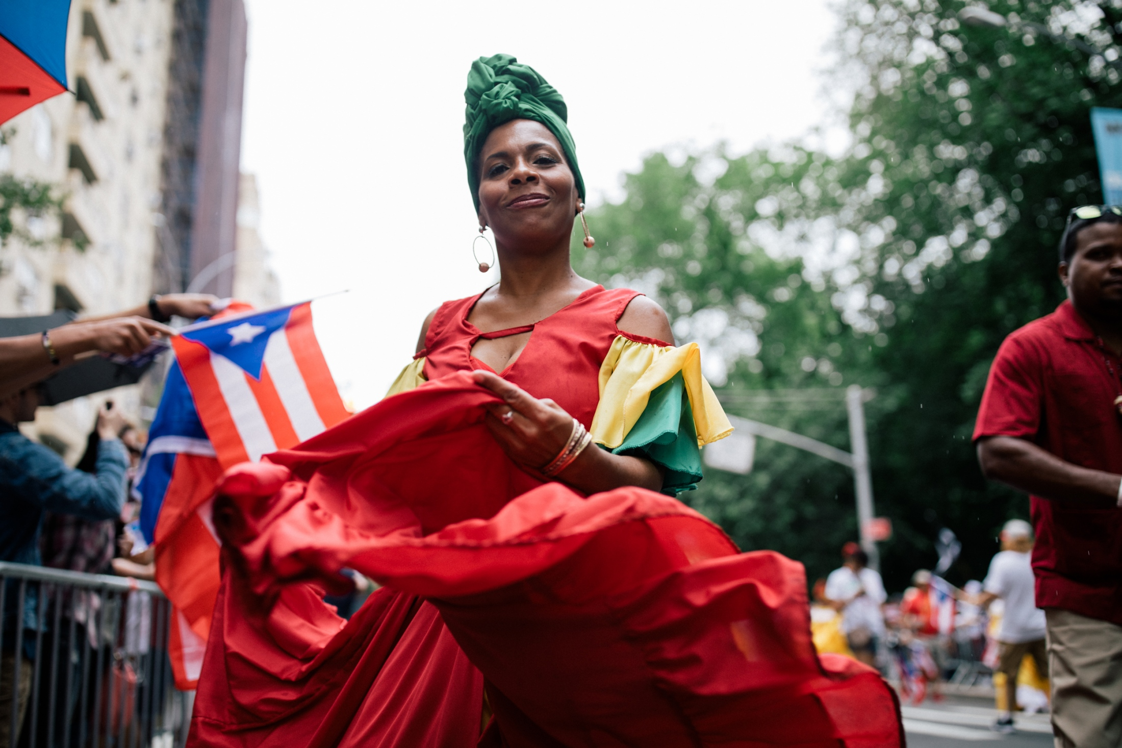 "A woman in a traditional ""bomba y plena"" dress performs folk dances at Fifth Avenue and 75th Street."