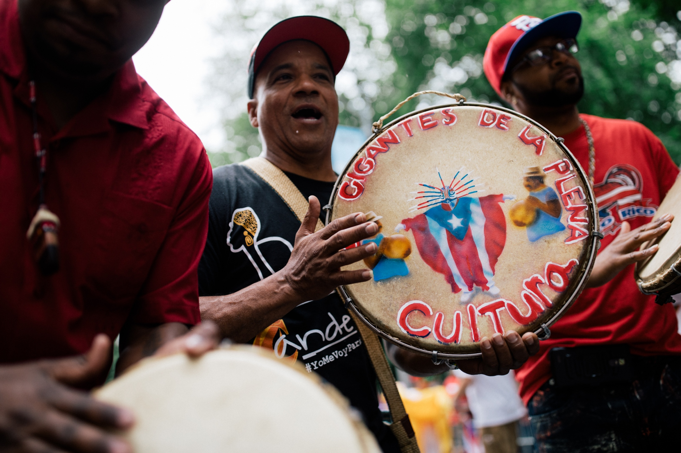 The music group Los Gigantes de la Plena play bomba, a traditional style of music that revolves around percussion, at Fifth Avenue and 75th Street.