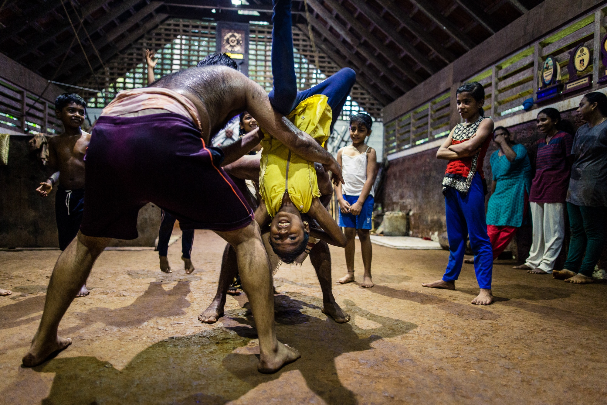Vatakara, Kerala, INDIA - September 16, 2017: Female students practice how to escape from grips. Since several rape cases in India received extensive media coverage and triggered protests in 2012, more young women have begun training at the school and an increasing number of parents allow their girls to train Kalaripayattu. Nowadays, one third of Meenakshi's students are females aged between six and twenty-six.