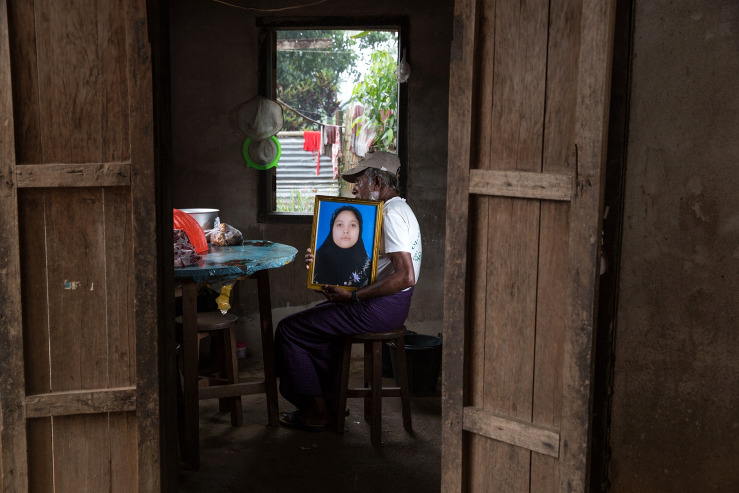 A local cosmetic shop owner awaits the return of his arbitrarily detained daughter Aye Aye San. He didn't want to show his face for fear of retribution. Myanmar military intelligence arrested Aye Aye San, 22, on her wedding day in Kunhein, Shan State on August 9, 2014.  On January 12, 2015, the Taunggyi District Court sentenced her along with her new husband Myo Min Htun, and their family and friends in trials that failed to meet fair trial standards to 14 years' imprisonment with hard labor under sections 5(J) and 5(L) of the 1950 Emergency Provisions Act.  In October 2016, the Myanmar government repealed the notoriously controversial 1950 Emergency Provisions Act, yet Aye Aye San and others remain detained under the now defunct Act.