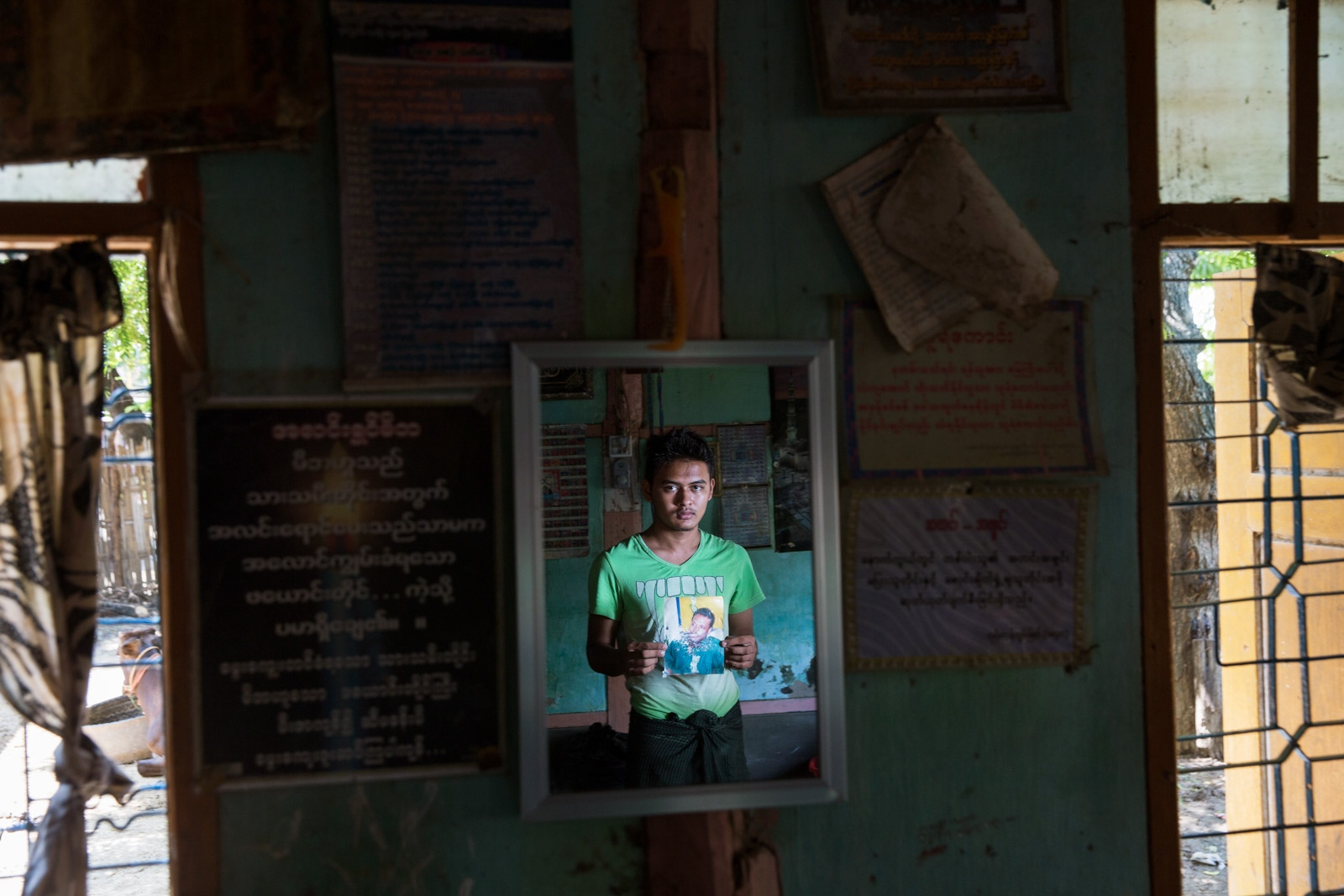 The nephew of arbitrarily detained Soe Min Naing, 37, holds his uncle's portrait. Myanmar military intelligence arrested Soe Min Naing, 26, while he was traveling to attend a wedding in Kunhein, Shan State on August 4, 2014. On January 12, 2015, the Taunggyi District Court sentenced him in a trial that failed to meet fair trial standards to 14 years' imprisonment with hard labor under sections 5(J) and 5(L) of the 1950 Emergency Provisions Act. In October 2016, the Myanmar government repealed the notoriously controversial 1950 Emergency Provisions Act, yet Soe Min Naing remains detained in Myaung Mya prison under the now defunct Act.
